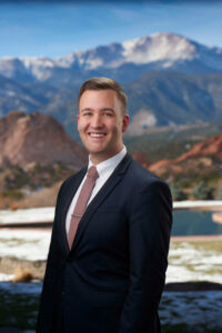 Chris Karpov as Director of Front Office of Garden of the Gods Resort and Club