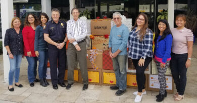 City of South Miami officials and Interval International employees celebrate the company's 23rd annual Thanksgiving Food Drive.