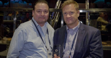 """Alex Gata (l) and Stephen Green accept SPI award for """"Best Business Product."""""""
