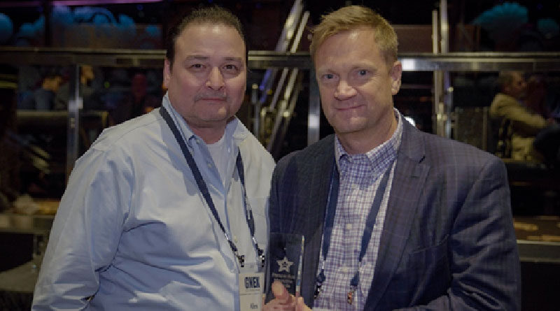 "Alex Gata (l) and Stephen Green accept SPI award for ""Best Business Product."""