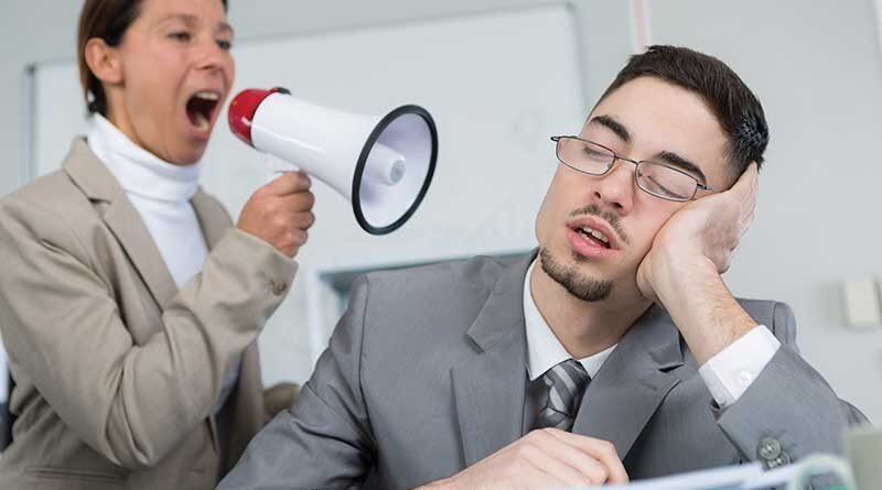 Business woman near workmate asking him to wake up